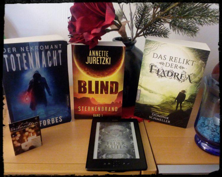 Lesetipps: Foto mit den Taschenbüchern zu Totennacht, Blind und Das Relikt der Fladrea, Ebook zu Tanz der Feuerblüten